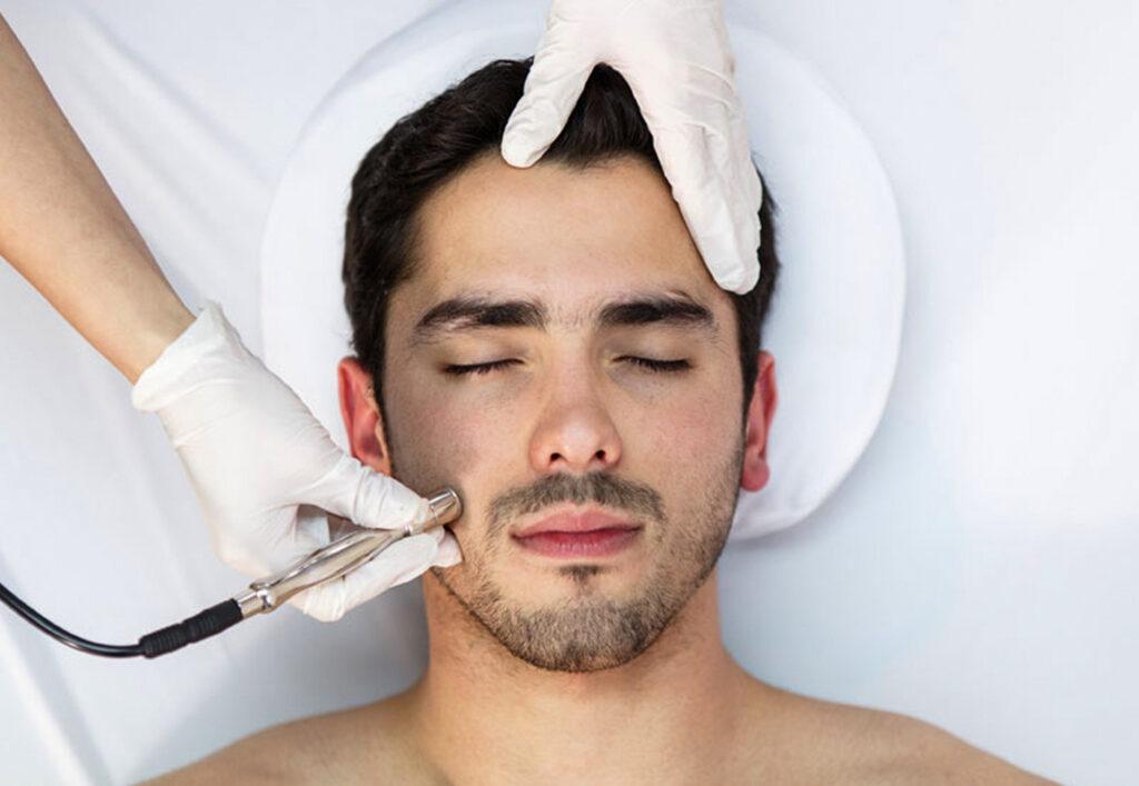 man receiving microdermabrasion